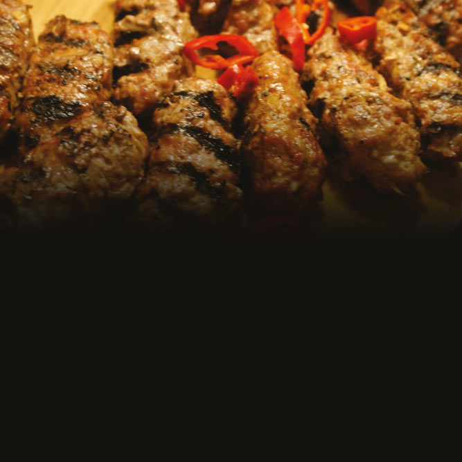 Cevapcici over flames